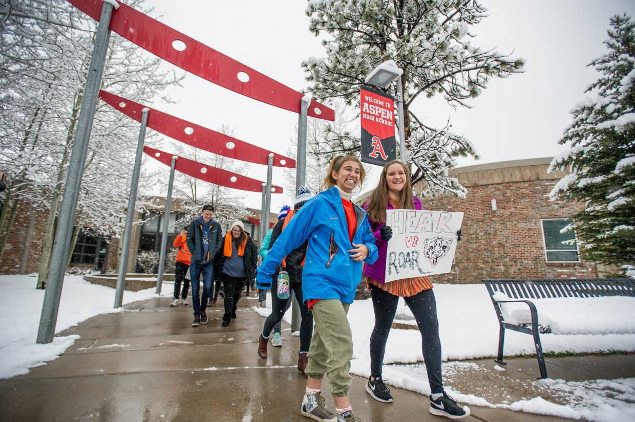 The student walkout at Aspen High School lead by Zoe Cramer, left, and Emily Driscoll on Friday addressing all of the school shootings.