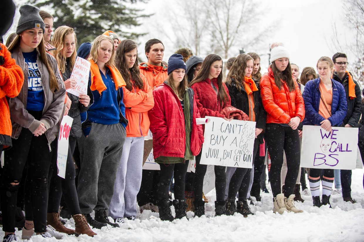 Aspen High School students and supporters listen to speakers at Paepcke Park on Friday for a student-organized walkout addressing all of the school shootings and gun control.