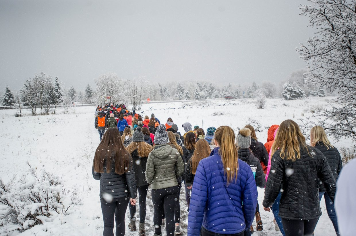 Students of Aspen High School marching towards Paepcke Park on Friday for a student-organized walkout addressing all of the school shootings.
