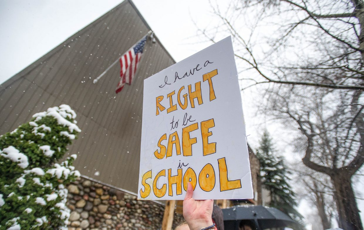 A sign held by Aspen High School students marching towards Paepcke Park on Friday for a student-organized walkout addressing all of the school shootings.
