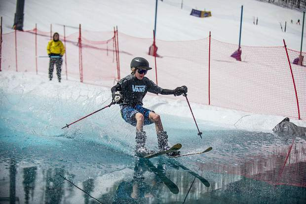 Owen Nelson,12, skis across the pond skim at Snowmass for closing weekend on Sunday.