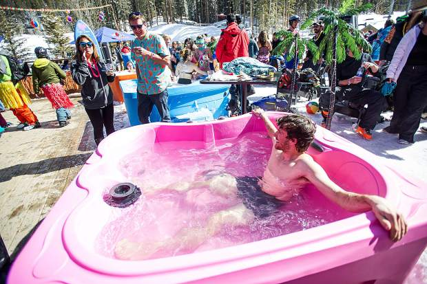 A partier lounges in a hot tub at Elk Camp Lodge on Saturday for closing weekend at Snowmass.