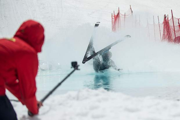 40-year-old New Yorker Chip Foley wipes out during the pond skim on Sunday at Snowmass for closing weekend.