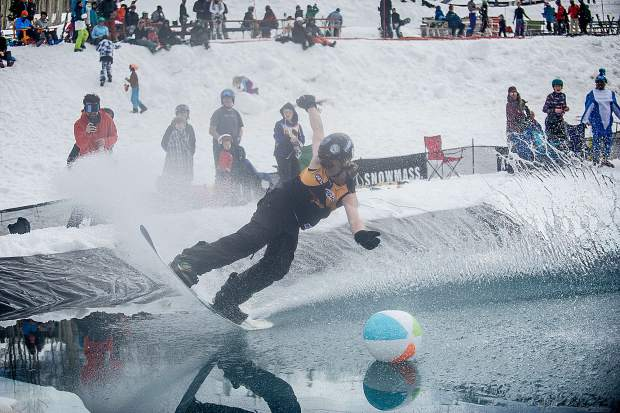 Jamie Murphy snowboards across the pond skim at Snowmass on Sunday for closing weekend.