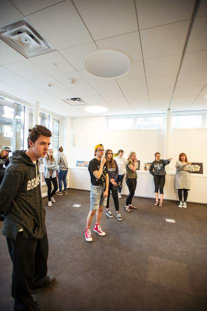 Young curators mull over artwork placement at the Aspen Art Museum on Tuesday.