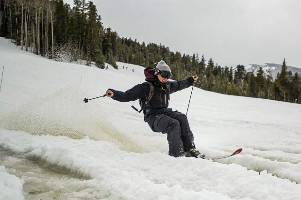 A skier goes through some melted snow on Sunday at Aspen Highlands for closing day.