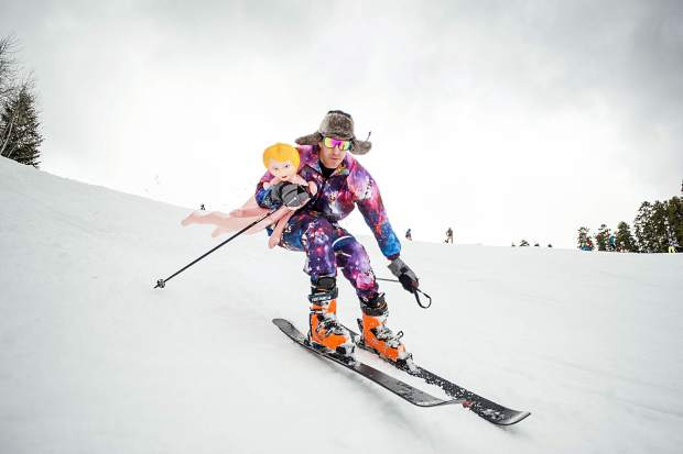 Dave Falden skis down with his blow up doll Sunday at Aspen Highlands for their closing day.