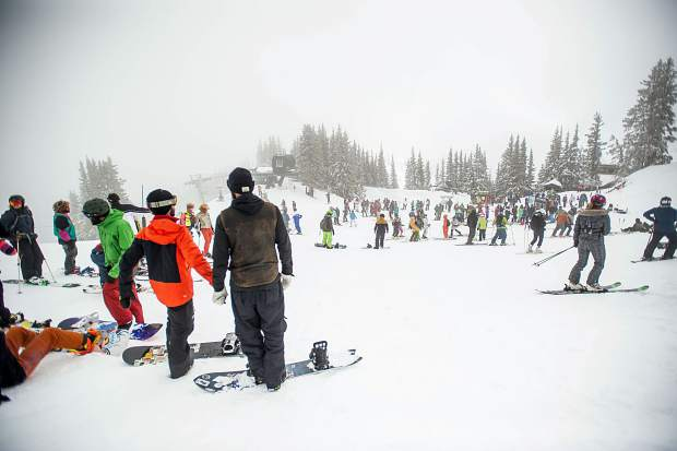Crowds gather waiting to hear the verdict of the Bowl opening at Aspen Highlands on Sunday for closing day. Due to conditions the Bowl was unable to open.