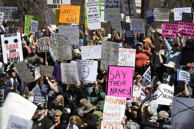 Colorado students and supporters demonstrate at Civic Center Park during the March for Our Lives to call on lawmakers to end gun violence and ensure students' safety, Saturday, March 24, 2018, in Denver. (Andy Cross/The Denver Post via AP)