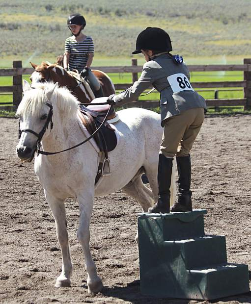 Ruby Walker mounts her pony for Strang Horse Show.