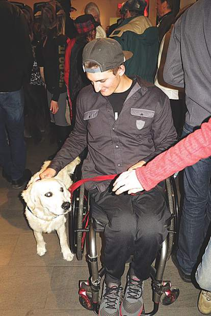Soren Lindholm with his pup, Rolo, at a Bridging Bionics event.