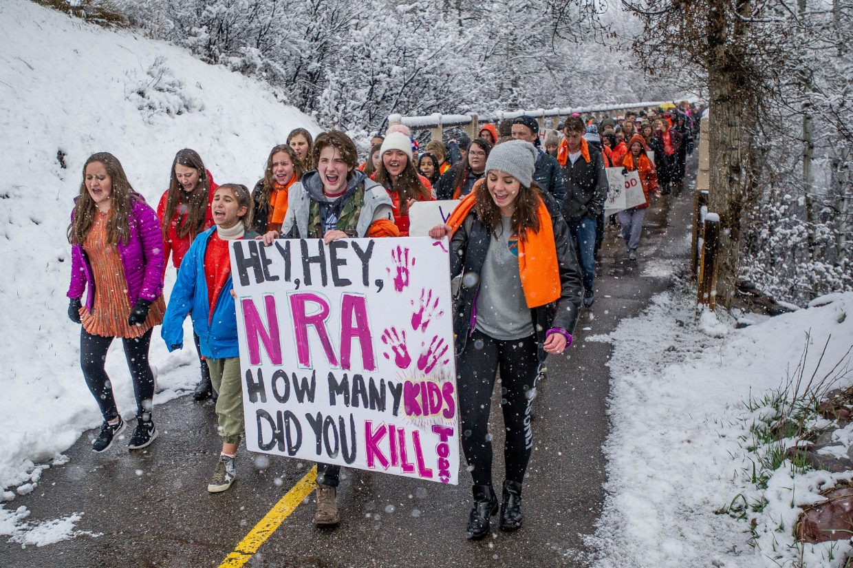 Students of Aspen High School crossing the Marolt pedestrian bridge in Aspen on Friday on their way to Paepcke Park for a student-organized walkout addressing all of the school shootings.