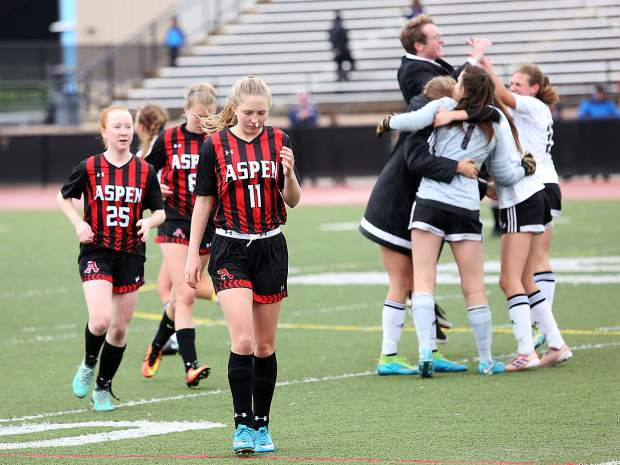 Aspen junior Emily Brenniger leads a group of Skiers off the field as Jefferson Academy celebrates a 1-0 win over the Skiers in Saturday's 3A state semifinal game at All-City Stadium in Denver.