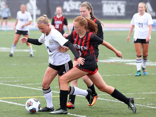 Aspen freshman Edie Sherlock, right, chases down a Jefferson Academy attacker during Saturday's semifinal game in Denver.
