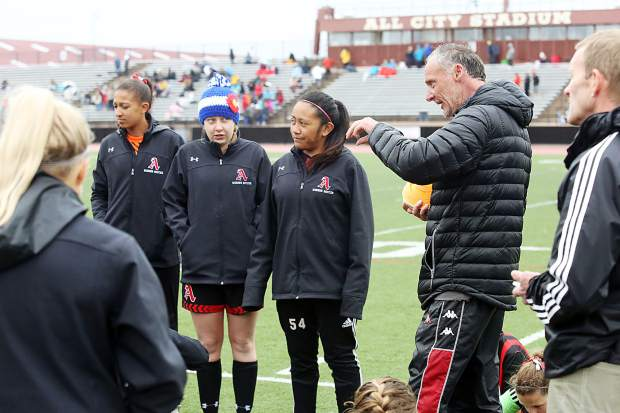Aspen girls soccer coach John Gillies talks to the players during halftime of Saturday's state semifinal game against Jefferson Academy in Denver.