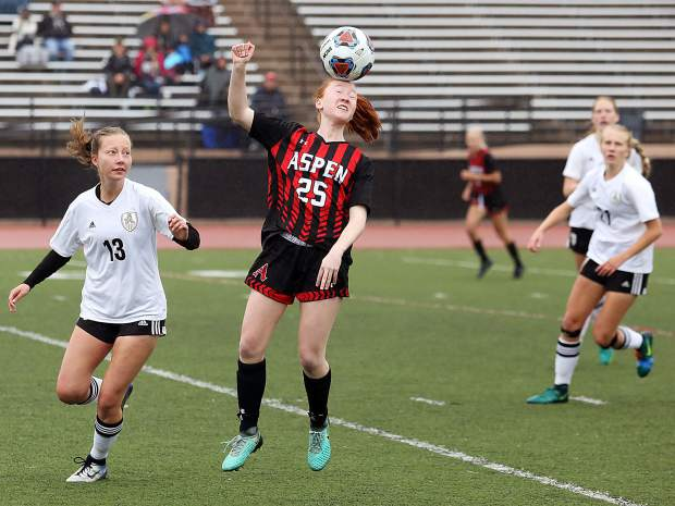 Aspen freshman Kelley Francis tries to control the ball with her head during Saturday's game against Jefferson Academy in Denver.