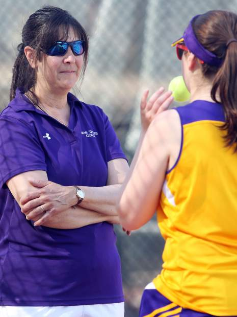 Basalt High School girls tennis coach Diana Elliott talks to her daughter, No. 1 singles player Mari Elliott, during a match earlier this season against Aspen at Crown Mountain Park in El Jebel.