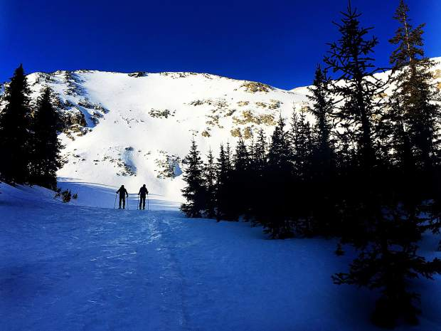 Backcountry skiers touring out to Mount Hayden.