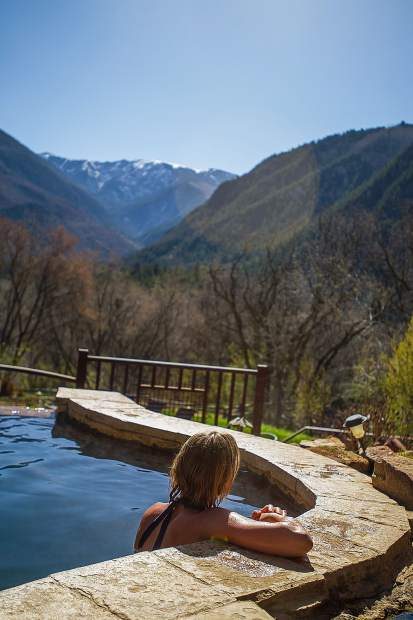 Erin Hood of Eagle relaxes in one of the upper pools at the Avalanche Ranch hot springs on Friday morning. Avalanche Ranch boasts three natural hot springs, designed around the natural landscape and rock formations of the Crystal River Valley.