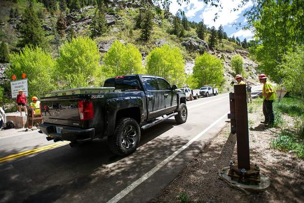 The first vehicle in line, filled with a family from Ava, Missouri drives through the opened gate from Colorado Department of Transportation workers on Independence Pass Road on Thursday at noon for car traffic for the summer season.