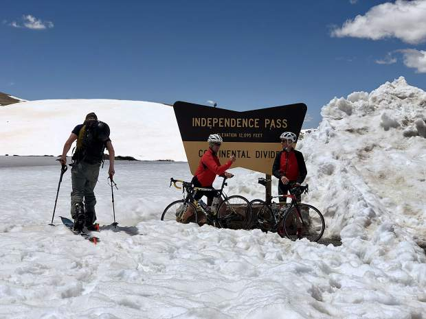 May means multi-sport days for Aspenites, and in true local fashion, folks gathered at the top of Independence Pass after it opened at noon Friday with skis and snowboards, skins, bikes, kayaks, and motorcycles.