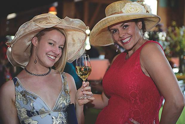 Megan Tacketta and Dani Kopf with chic chapeaux (French for fashionable hats).