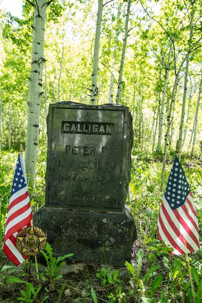 The gravestone of World War I veteran Peter Galligan is on the far east side at the Aspen Grove Cemetery. Sexton JIm Markalunas and his daughter placed flags at all of the veteran's gravestones for Memorial Day weekend.