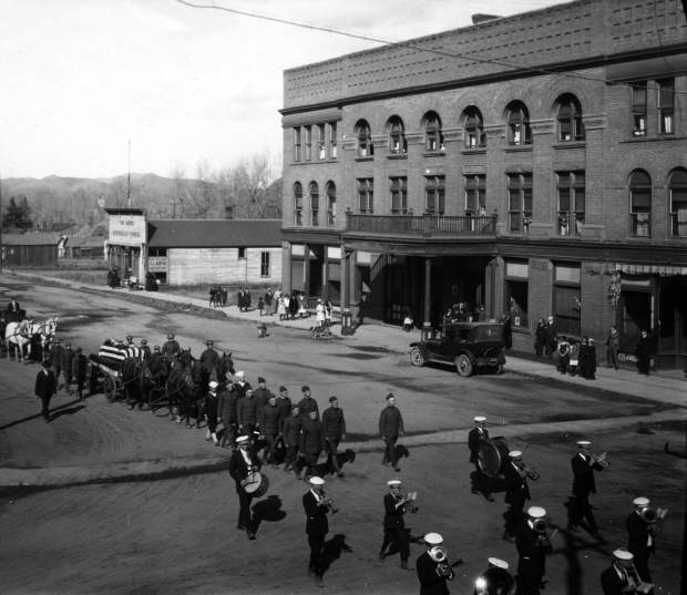The funeral procession for Cpl. Peter Galligan goes down Main Street in front of the Hotel Jerome. According to news reports, the entire town, including 200 children, walked in the procession along with a band and soldiers following with a horse pulling the American flag covered coffin.