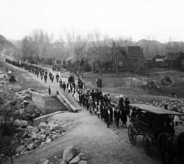 The funeral procession, including a horse-drawn carriage carrying Cpl. Peter Galligan, crosses over the Cooper Avenue Bridge going toward Independence Pass to the Aspen Grove Cemetery.
