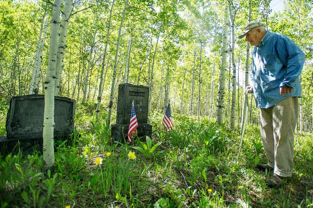 Aspen Grove Cemetery sexton Jim Markalunas stands in front of the gravestone of World War I veteran Peter Galligan on Thursday morning. Markalunas has been taking care of the cemetery for more than 30 years.