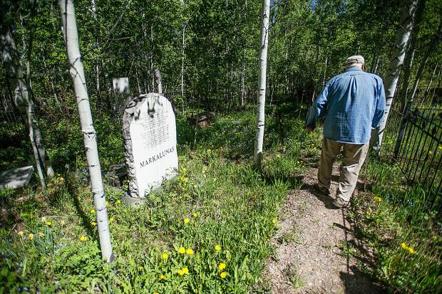 Aspen Grove Cemetery sexton Jim Markalunas walks by his wife Ramona's gravestone during a tour last week.