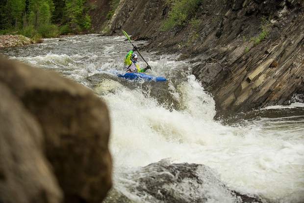 Jimmy Elsen descends on Slaughterhouse Falls on the Roaring Fork River in Aspen on Wednesday evening for the fourth annual Slaughterfest race. The racers kayak or raft a 4.5-mile stretch from Henry Stein Park down to Jaffee Park. This year's winners were Jules Cambell for kayaking and Team 9Ball formulated with U.S. men's raft team members.