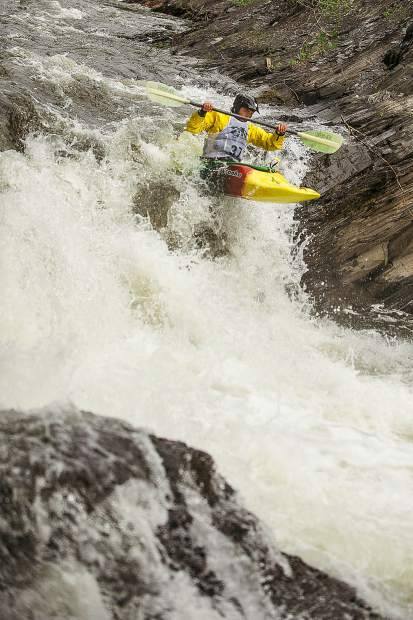 A racer drops down Slaughterhouse falls on Wednesday evening for the Slaughterfest race.