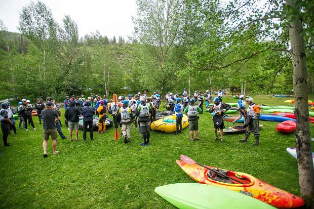 Racers listen to instructions before starting the race on the Roaring Fork River for the fourth annual Slaughterfest at Henry Stein Park on Wednesday evening. Kayakers and rafters paddled a 4.5-mile stretch from Henry Stein Park down to Jaffee Park. This year's winners were Jules Campbell for kayaking and Team 9Ball for rafting.