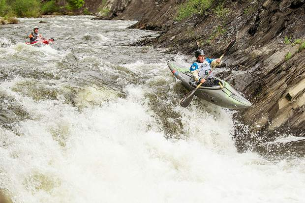 Andrew Billmeyer descends on Slaughterhouse Falls on the Roaring Fork River in Aspen on Wednesday evening for the fourth annual Slaughterfest race followed by kayaker Morgan Boyles. The racers kayak or raft a 4.5-mile stretch from Henry Stein Park down to Jaffee Park. This year's winners were Jules Cambell for kayaking and Team 9Ball formulated with the U.S. men's raft team members.