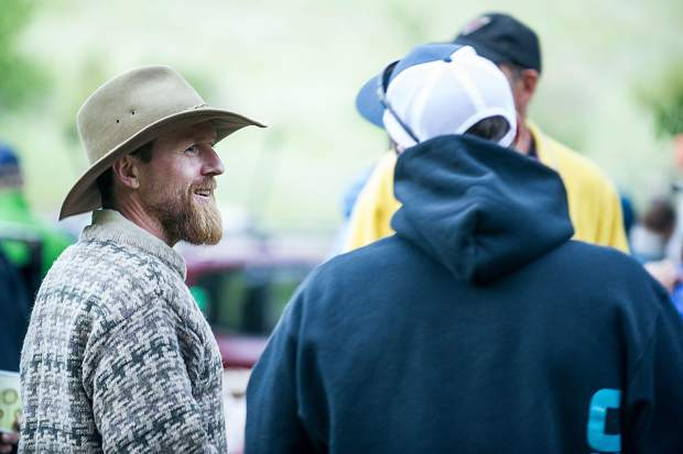 Jules Campbell smiles as he waits for results of the fourth annual Slaughterfest race at Jaffee Park on Wednesday evening. Kayakers and rafters paddled a 4.5-mile stretch from Henry Stein Park down to Jaffee Park. Campbell took first place in the kayak race.