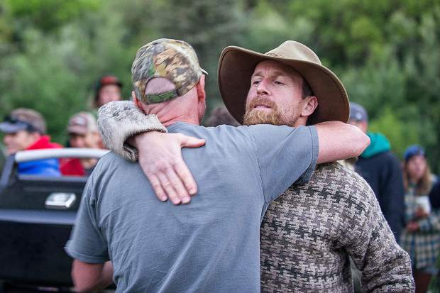 Jules Campbell hugs event organizer Paul Tefft after winning the fourth annual Slaughterfest race at Jaffee Park on Wednesday evening. Kayakers and rafters paddled a 4.5-mile stretch from Henry Stein Park down to Jaffee Park.