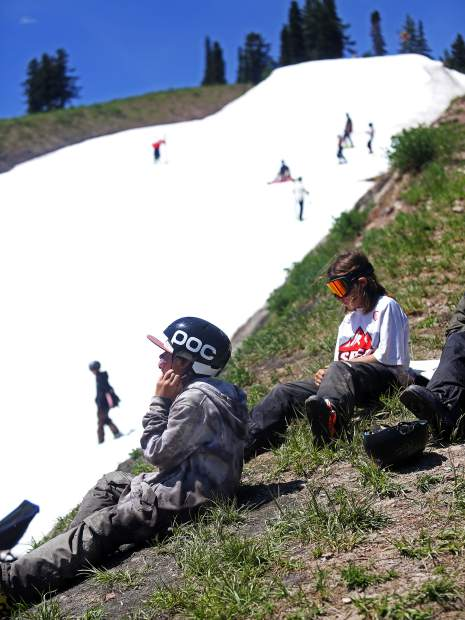 Attendees take a break during the AVSC Glacier Camp on Tuesday, June 26, 2018, at Buttermilk Ski Area. (Photo by Austin Colbert/The Aspen Times).