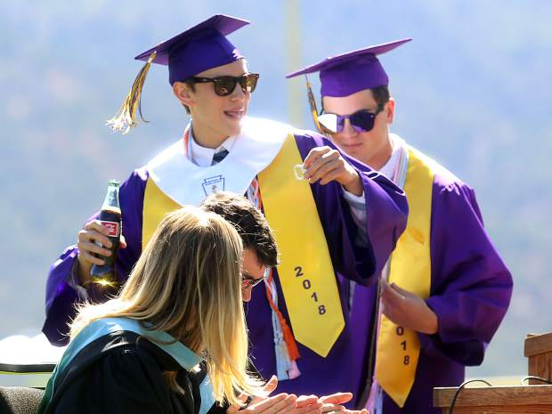 Co-valedictorian Will Orben dances off the stage with a bottle of coke during Basalt High's graduation on Saturday.