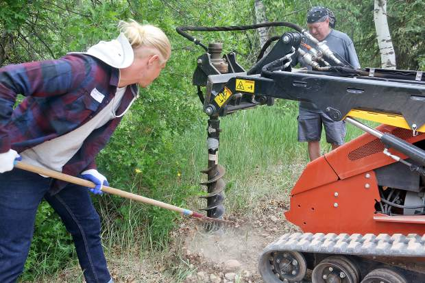 Volunteers work near the Aspen Camp of the Deaf and Hard of Hearing headquarters on Saturday in Old Snowmass. This past weekend was the camp's annual