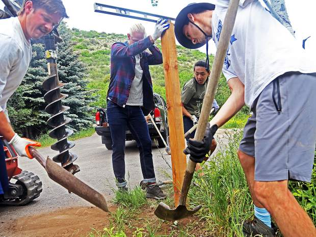 Volunteers erect a new post near the Aspen Camp of the Deaf and Hard of Hearing headquarters on Saturday in Old Snowmass. This past weekend was the camp's annual