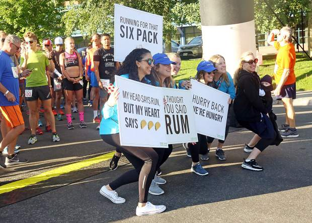 Runners are presented with some extra motivation prior to the start of the Food & Wine Celebrity Chef 5K Charity Run on Friday at Rio Grande Park in Aspen.