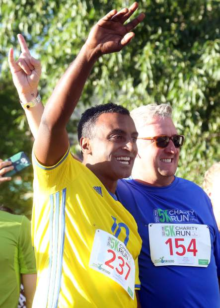 Marcus Samuelsson, left, and Tim Love take a photo ahead of the Food & Wine Celebrity Chef 5K Charity Run on Friday at Rio Grande Park in Aspen.