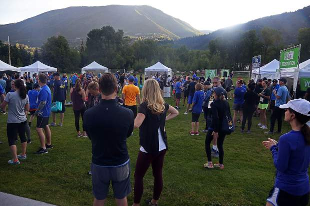 People gather ahead of the start of the Food & Wine Celebrity Chef 5K Charity Run on Friday at Rio Grande Park in Aspen.