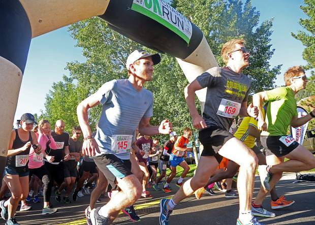 Runners take off from the start of the Food & Wine Celebrity Chef 5K Charity Run on Friday at Rio Grande Park in Aspen.