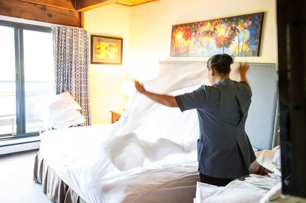 A member of Cecilia Rivera's housekeeping staff cleans a studio apartment at Aspen Square Condominium Hotel.