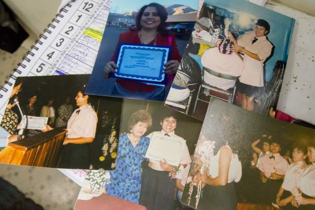 Rosa Contreras of Carbondale displays photos from her cosmetology graduation ceremony in Guatemala and holding her Colorado certificate last year.