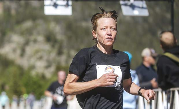 2018 Run The Rockies half-marathon first-place female finisher Amity Elliot of Louisville finishes with a time of 1 hour 34 minutes and 2 seconds on Saturday in Frisco.