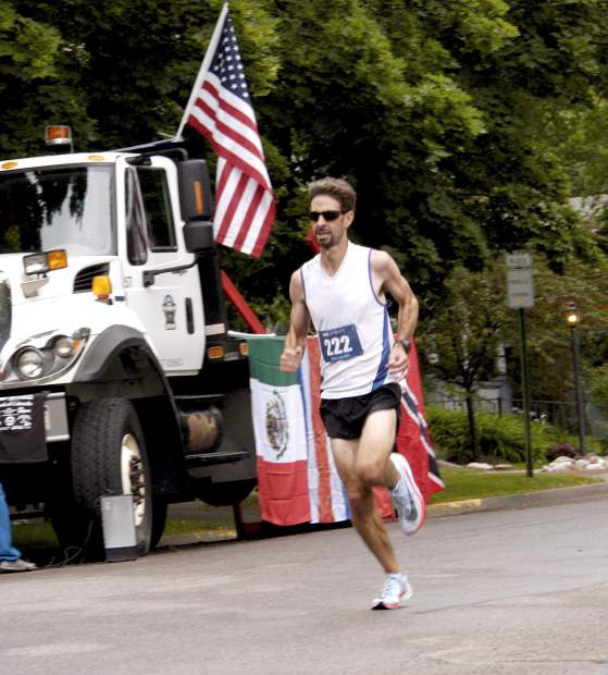 Adam Rich makes his way to the finish line of the Strawberry Shortcut 5K race Sunday morning, shortly after also winning the 10K event.