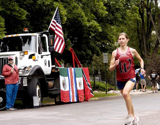 Tara Richardson makes her way to the finish line of the Strawberry Shortcut 5K race Sunday morning, shortly after also winning the 10K event.
